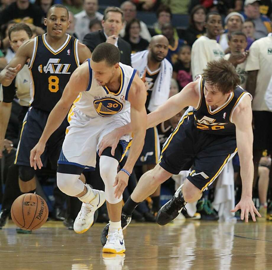 The Warriors' Stephen Curry battles for the ball with Utah's Gordon Hayward during a game against the Jazz in Oakland, Calif., on Sunday, April 7, 2013. The Jazz won 97-90. Photo: Mathew Sumner, Special To The Chronicle
