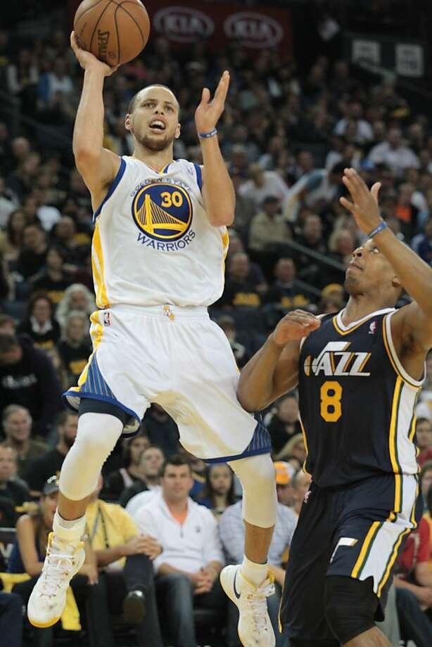 The Warriors' Stephen Curry puts up a shot over Utah's Randy Foye during a game against the Jazz in Oakland, Calif., on Sunday, April 7, 2013. The Jazz won 97-90. Photo: Mathew Sumner, Special To The Chronicle