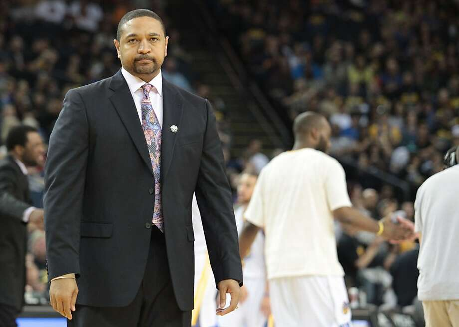 Warriors head coach Mark Jackson walks on the court after calling a time out during 97-90 loss to the Jazz in Oakland, Calif., on Sunday, April 7, 2013. Photo: Mathew Sumner, Special To The Chronicle
