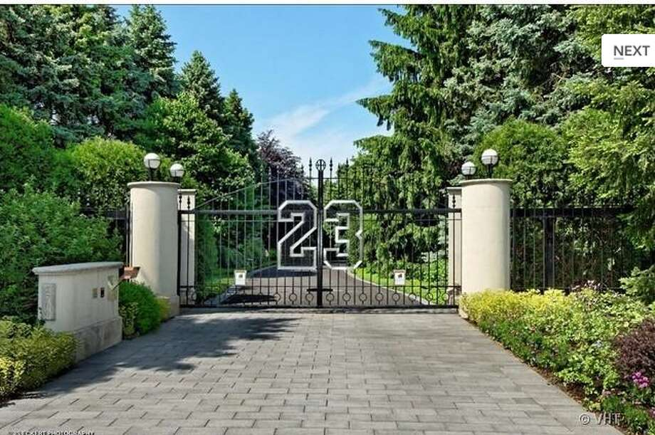 Undeniably Michael Jordan, the former NBA star had his jersey number emblazoned across the home\'s front gates.  The home has been reduced to $21 million from its original ask of $29 million.