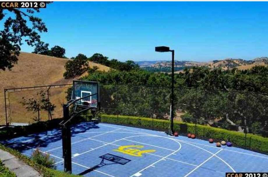 The outdoor basketball court with the signature Cal logo.  This photo was pulled from the listing after Tedford\'s departure.
