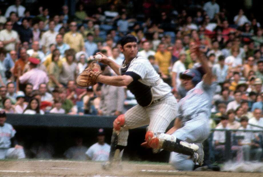 New York Yankee Thurman Munson, a pilot for about a year, was in his personal plane with a friend and flight instructor practicing touch-and-go landings, when he clipped a tree short of the runway and crash. Photo: Focus On Sport, Getty Images / 1969 Focus on Sport