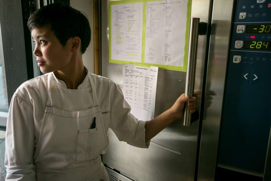 Marielle Fabie looks out the door as she waits for a sauce to cool in the blast chiller at Saison.