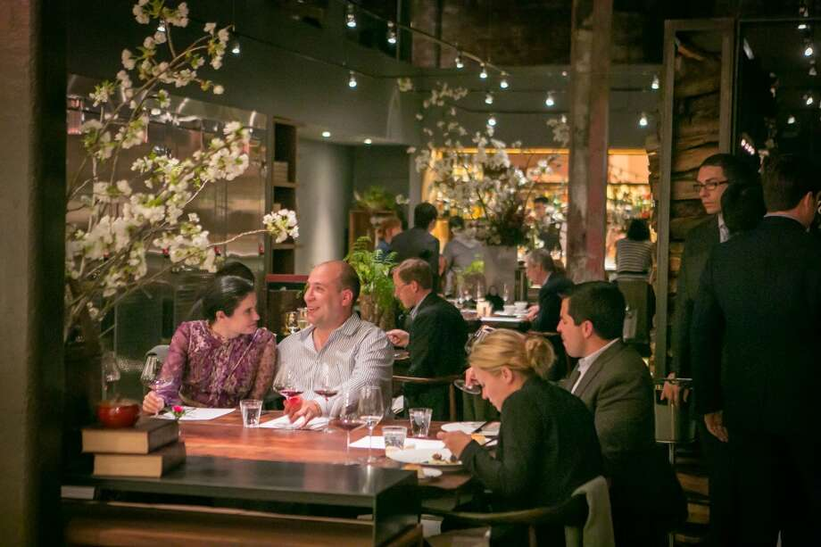 Diners enjoy dinner at Saison.