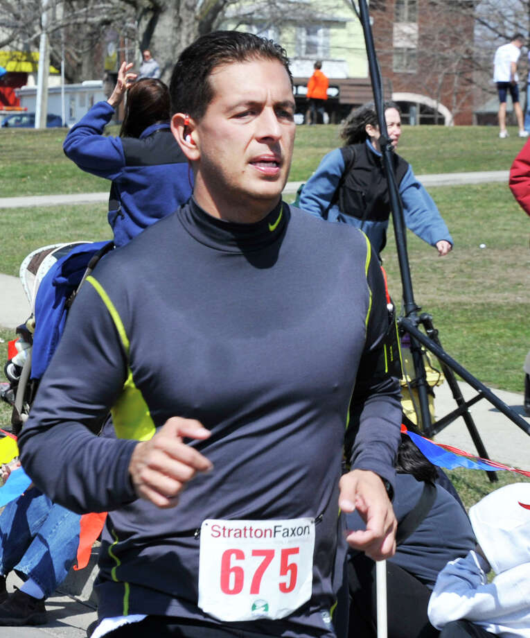 Jason Sonski finishes the Half Marathon during the Stratton Faxon Greater Danbury Half Marathon and 5K race in Danbury, Conn. Sunday, April 7, 2013. Photo: Michael Duffy / The News-Times