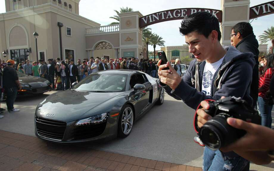 Emanuel Alvarez, 16, joins other sports car enthusiasts while attending the Coffee and Cars' at Vintage Park on Saturday, April 6, 2013, in Houston. Photo: Mayra Beltran, Houston Chronicle / © 2013 Houston Chronicle
