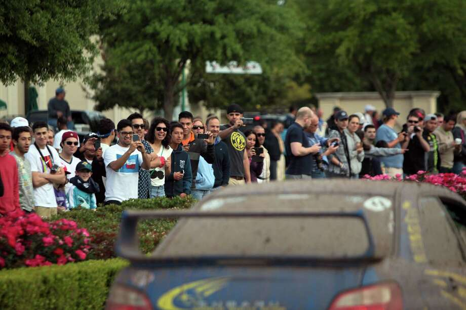 Sports car enthusiasts attend the Coffee and Cars' auto show at Vintage Park on Saturday, April 6, 2013, in Houston. Photo: Mayra Beltran, Houston Chronicle / © 2013 Houston Chronicle