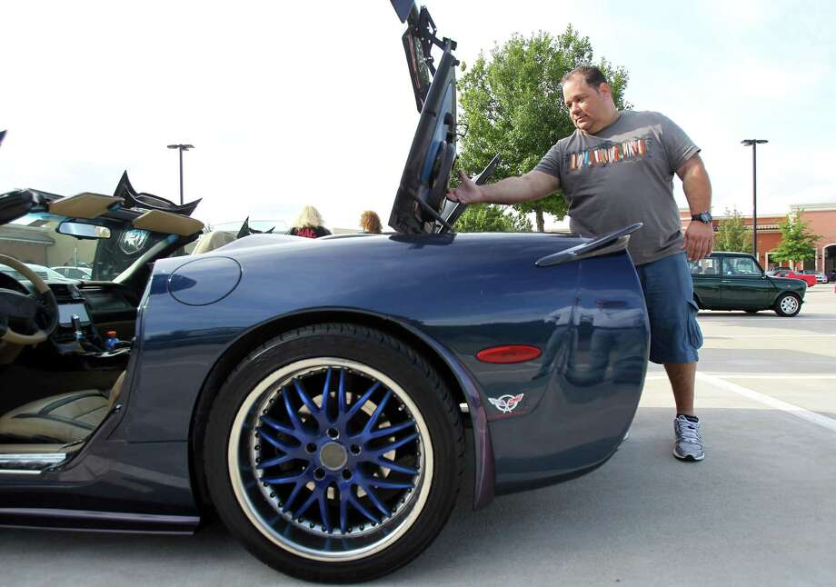Alex Cespedes, owner of a corvette, has his vehicle on display during the Coffee and Cars' autoshow at Vintage Park on Saturday, April 6, 2013, in Houston. Photo: Mayra Beltran, Houston Chronicle / © 2013 Houston Chronicle