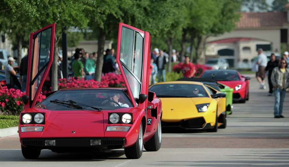Lamborghinis parade down the street at the Coffee and Cars auto show at Vintage Park on Saturday, April 6, 2013, in Houston. Photo: Mayra Beltran, Houston Chronicle / © 2013 Houston Chronicle