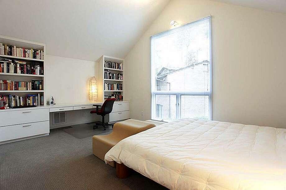 Secondary bedroom. Cathedral ceilings,. Spot lighting. Floor to ceiling windows. Great storage. Private bathrooms en suite. Photo: Greenwood King Properties