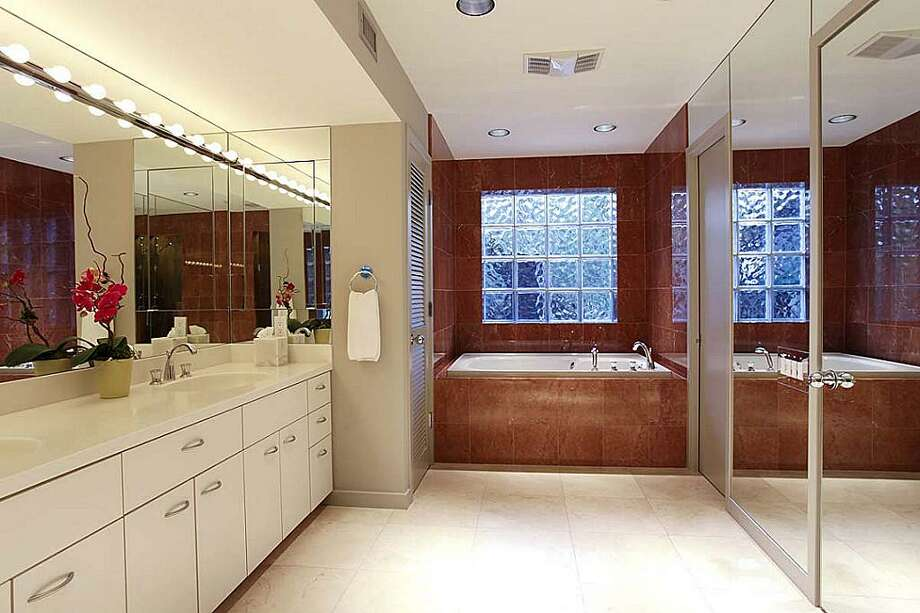 Master bathroom. Polished marble floor.Recessed and vanity lighting. Photo: Greenwood King Properties