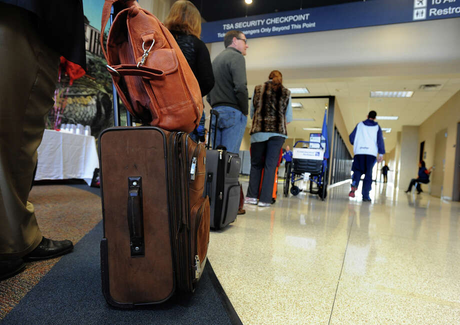 Travelers wait in line at the Jack Brooks Regional Airport to board American Airline's inaugural flight out of Beaumont on Thursday. Photo taken Thursday, February 14, 2013 Guiseppe Barranco/The Enterprise Photo: Guiseppe Barranco, STAFF PHOTOGRAPHER / The Beaumont Enterprise