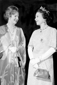 Queen Elizabeth II and Prime Minister Margaret Thatcher at a ball to celebrate the Commonwealth Heads of Government Conference hosted by President Kenneth Kaunda in Lusaka, Zambia, October 1979. Photo: Tom Stoddart Archive, File / 2007 Getty Images