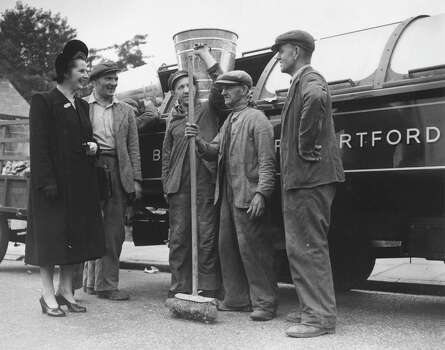 Margaret Roberts, Conservative candidate for Dartford, Kent and youngest woman candidate in the election, talking to dustmen during her election campaign in 1951. Photo: Central Press, File / Hulton Archive