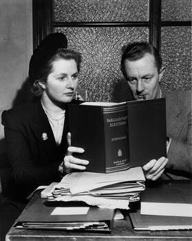 Future British Prime MInister Margaret Roberts studying a parliamentary reference book with a colleague in 1950 during her period as Britain's youngest parliamentary candidate. Photo: Chris Ware, File / Hulton Archive