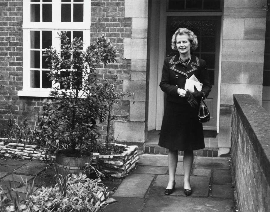British politician Margaret Thatcher leaving her Chelsea home to attend the second ballot in the election for the leadership of the Conservative party in 1975. Photo: Roger Jackson, File / Hulton Archive