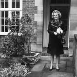 British politician Margaret Thatcher leaving her Chelsea home to attend the second ballot in the election for the leadership of the Conservative party in 1975.