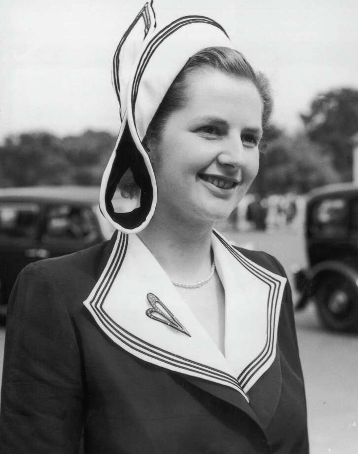 British prime minister Margaret Thatcher, then Miss Margaret Roberts, attending a garden party at Buckingham Palace, as a Conservative MP in 1950. Photo: Central Press, File / Hulton Archive