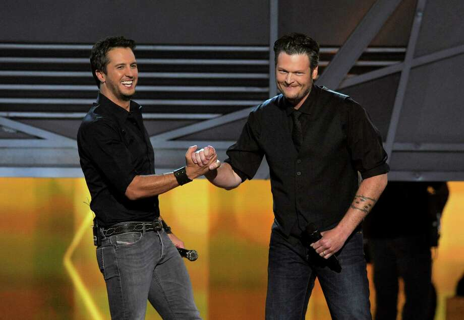 Luke Bryan, left, and Blake Shelton speak on stage at the 48th Annual Academy of Country Music Awards at the MGM Grand Garden Arena in Las Vegas on Sunday, April 7, 2013. (Photo by Chris Pizzello/Invision/AP) Photo: AP