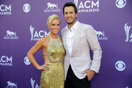 Singer Luke Bryan, right, and Caroline Bryan arrive at the 48th Annual Academy of Country Music Awards at the MGM Grand Garden Arena in Las Vegas on Sunday, April 7, 2013. (Photo by Al Powers/Invision/AP) Photo: AP