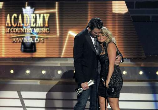 """Miranda Lambert, right, and Blake Shelton accept the award for song of the year for """"Over You"""" at the 48th Annual Academy of Country Music Awards at the MGM Grand Garden Arena in Las Vegas on Sunday, April 7, 2013. (Photo by Chris Pizzello/Invision/AP) Photo: AP"""