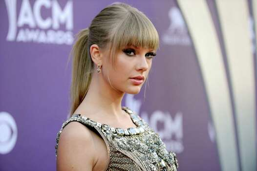 Singer Taylor Swift arrives at the 48th Annual Academy of Country Music Awards at the MGM Grand Garden Arena in Las Vegas on Sunday, April 7, 2013. (Photo by Al Powers/Invision/AP) Photo: AP