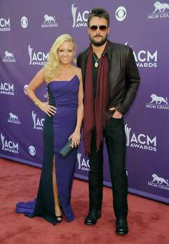 Singer Eric Church, right, and Katherine Blasingame arrive at the 48th Annual Academy of Country Music Awards at the MGM Grand Garden Arena in Las Vegas on Sunday, April 7, 2013. (Photo by Al Powers/Invision/AP) Photo: AP