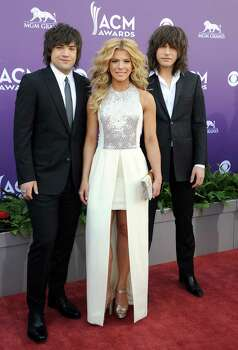 From left, Neil Perry, Kimberly Perry and Reid Perry, of musical group The Band Perry, arrive at the 48th Annual Academy of Country Music Awards at the MGM Grand Garden Arena in Las Vegas on Sunday, April 7, 2013. (Photo by Al Powers/Invision/AP) Photo: AP