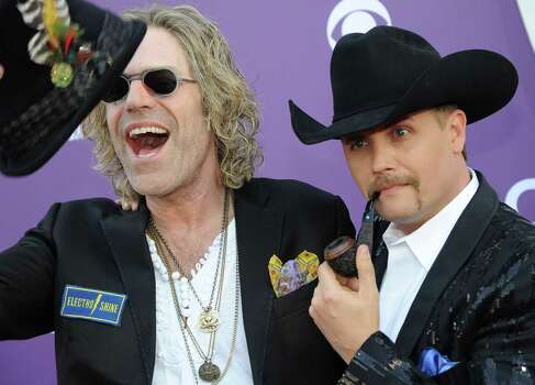 Big Kenny, left, and John Rich, of musical duo Big & Rich, arrive at the 48th Annual Academy of Country Music Awards at the MGM Grand Garden Arena in Las Vegas on Sunday, April 7, 2013. (Photo by Al Powers/Invision/AP) Photo: AP