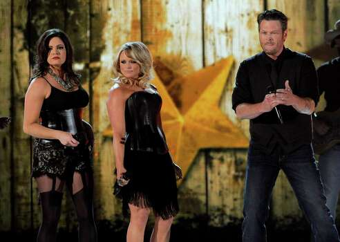 From left, Angaleena Presley and Miranda Lambert of musical group Pistol Annies, and singer Blake Shelton perform at the 48th Annual Academy of Country Music Awards at the MGM Grand Garden Arena in Las Vegas on Sunday, April 7, 2013. (Photo by Chris Pizzello/Invision/AP) Photo: AP