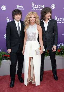 LAS VEGAS, NV - APRIL 07:  (L-R) Musicians Neil Perry, Kimberly Perry and Reid Perry of The Band Perry arrive at the 48th Annual Academy of Country Music Awards at the MGM Grand Garden Arena on April 7, 2013 in Las Vegas, Nevada. Photo: Jason Merritt, Getty Images / 2013 Getty Images