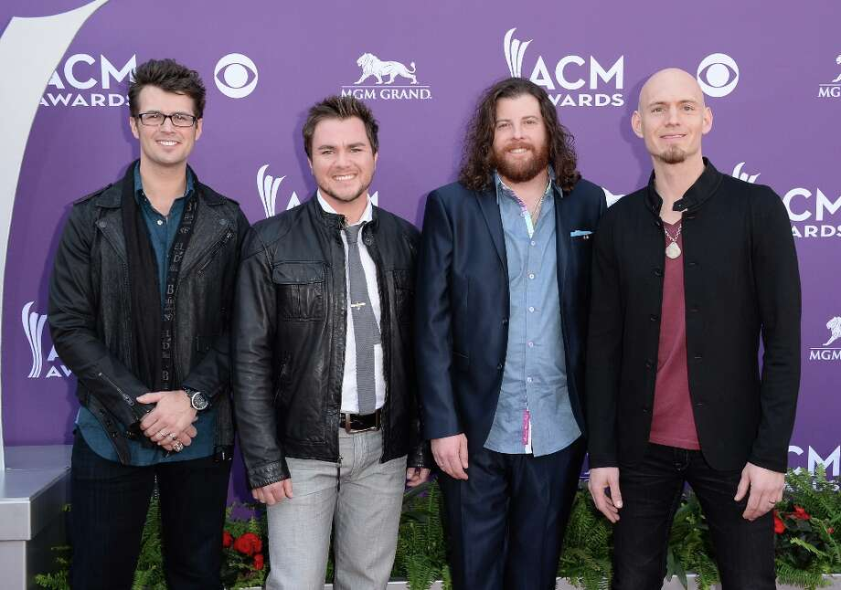 LAS VEGAS, NV - APRIL 07:  (L-R) Musicians Chris Thompson, Mike Eli, James Young, and Jon Jones of Eli Young Band arrive at the 48th Annual Academy of Country Music Awards at the MGM Grand Garden Arena on April 7, 2013 in Las Vegas, Nevada. Photo: Jason Merritt, Getty Images / 2013 Getty Images