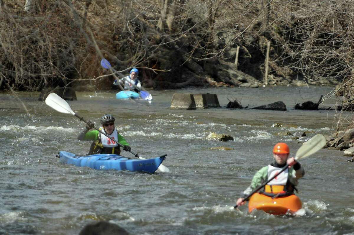 Kayakers, Howard Layer, left, and Pat Sleasman, right, make their way down the course during the 40th running of the Tenandeho Boat Races on Sunday, April 7, 2013 in Mechanicville, NY. The races is open to kayaks, solo canoes, tandem canoes, and polers. Rescue volunteers were positioned after most of the big rapids in the course. (Paul Buckowski / Times Union)