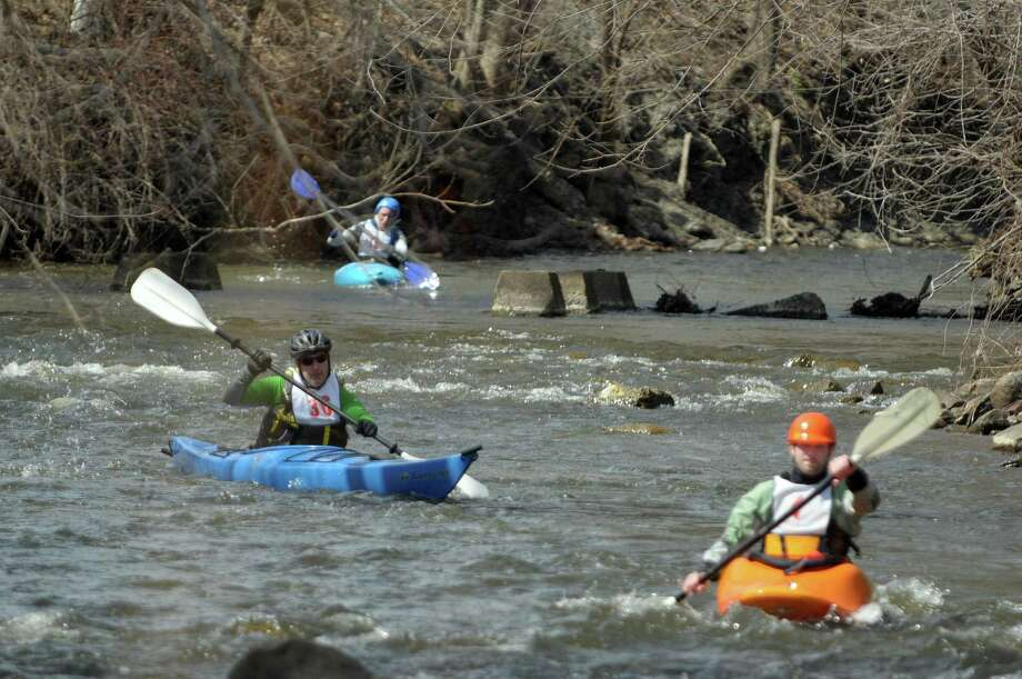 Kayakers, Howard Layer, left, and Pat Sleasman, right, make their way down the course during the 40th running of the Tenandeho Boat Races on Sunday, April 7, 2013 in Mechanicville, NY.  The races is open to kayaks, solo canoes, tandem canoes, and polers.  Rescue volunteers were positioned after most of the big rapids in the course.   (Paul Buckowski / Times Union) Photo: Paul Buckowski, Albany Times Union / 00021665A
