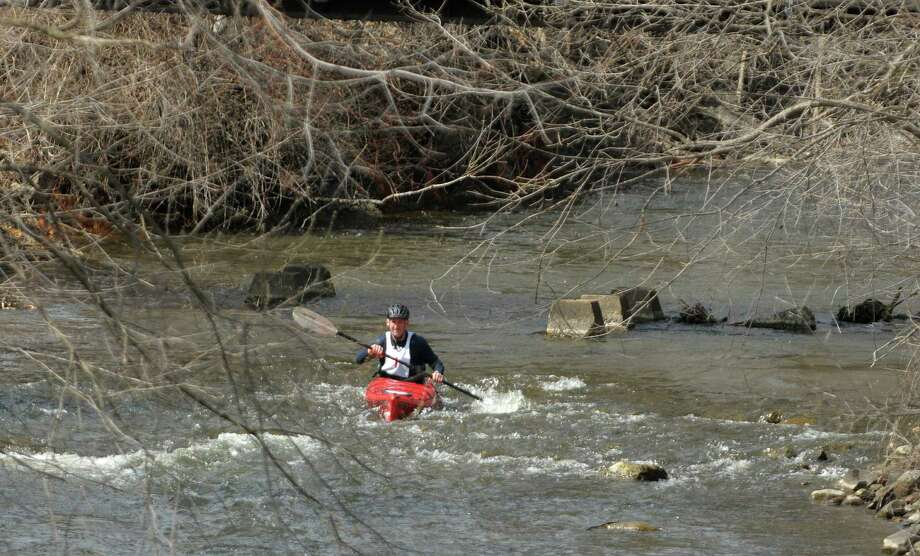 Joseph Spencer makes his way along the course in his kayak during the 40th running of the Tenandeho Boat Races on Sunday, April 7, 2013 in Mechanicville, NY.  The races is open to kayaks, solo canoes, tandem canoes, and polers.  Rescue volunteers were positioned after most of the big rapids in the course.   (Paul Buckowski / Times Union) Photo: Paul Buckowski, Albany Times Union / 00021665A