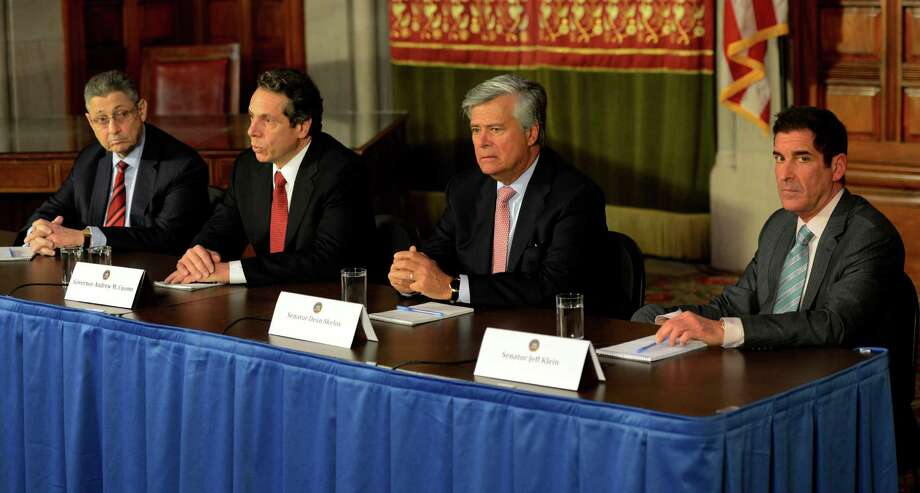 Governor Andrew Cuomo, second from left, was joined by Shelly Silver, speaker of the Assembly, left, Dean Skelos, republican conference leader, second from right, and Jeffrey Klein, independent democratic conference leader, right, Wednesday morning, Jan. 30, 2013, for a leaders' meeting in the Red Room of the State Capitol in Albany, N.Y. (Skip Dickstein/Times Union) Photo: SKIP DICKSTEIN / 00020970A
