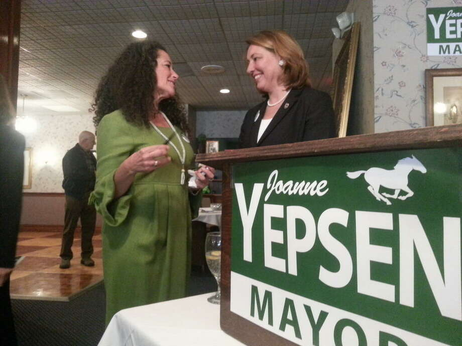 Joanne Yepsen, right, prepares to announce her candidacy for mayor of Saratoga Springs on Monday, April 8, 2013. With her is Ruth Wallens, a supporter. (Dennis Yusko/Times Union)