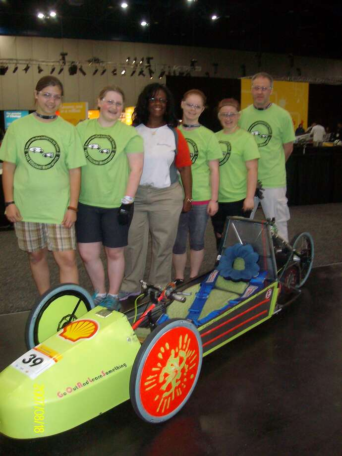 ShopGirls, one of only two all girl teams in the Shell Eco-marathon Americas event: Teagan Fife, 9th grader; Dansil Green, 10th grader, Robin Cole, Shell Safety Manager-Shell Technology Center; Samantha Miner-Ball, 9th grader; Kylee Hayter, 9th grader and Dave Green, Team Coach.
