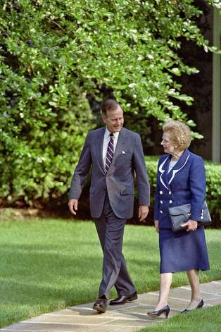 "A picture dated June 20, 1991 shows US President George Bush (L) walking with former British Prime Minister Margaret Thatcher (R) as they leave the Oval Office at the White House. Former British prime minister Margaret Thatcher, the ""Iron Lady"" who shaped a generation of British politics, died following a stroke on April 8, 2013 at the age of 87, her spokesman said.  Photo: LUKE FRAZZA, AFP/Getty Images / AFP"