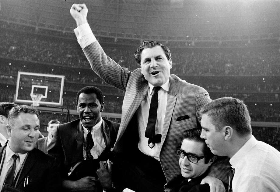 In 1968 and 1983 Lewis was named the National Coach of the Year. Photo: Ed Kolenovsky, AP / 1968 AP