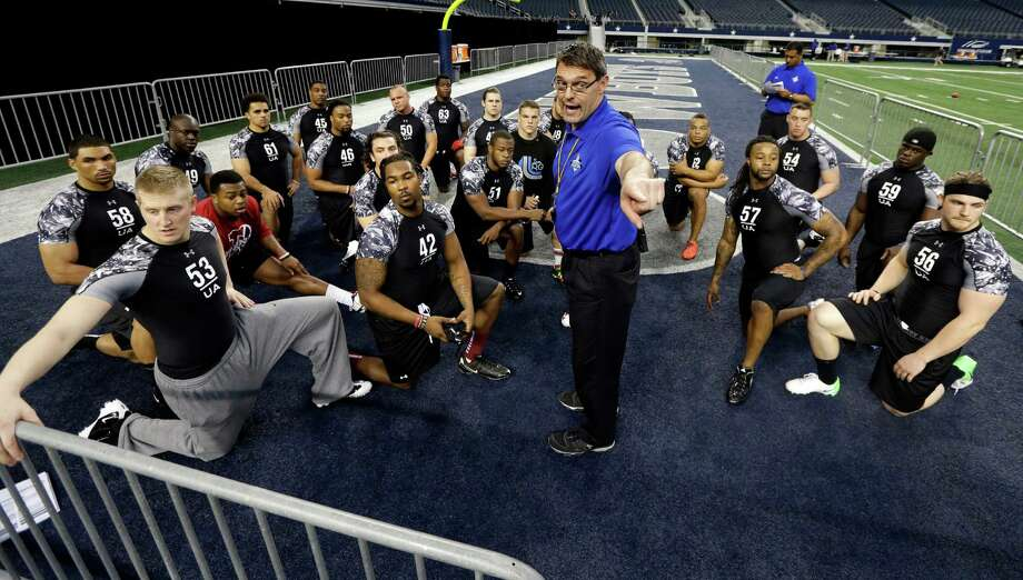 John Aaron, cente, gives instructions to linebackers before they participate in the 40-yard-dash during the NFL super regional football combine Sunday, April 7, 2013, in Arlington, Texas. (AP Photo/Tony Gutierrez) Photo: Associated Press