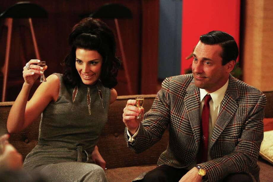 """Jessica Pare as Megan Draper and Jon Hamm as Don Draper in a scene of \""""Mad Men,\"""" Season 6, Episode 2. """"Mad Men"""" returns for its sixth season Sunday, April 7, 2013, on AMC with 13 new episodes. (AP Photo/AMC, Michael Yarish) Photo: Michael Yarish, Associated Press / AMC"""