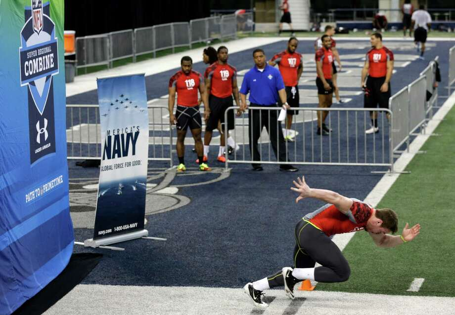 Jordan Roberts, front, runs the 40-yard-dash as other running backs wait their turn during the NFL super regional football combine Sunday, April 7, 2013, in Arlington, Texas. (AP Photo/Tony Gutierrez) Photo: Associated Press