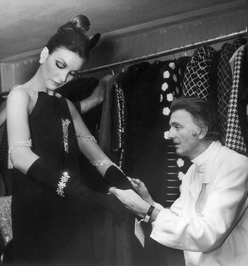 The French fashion designer Hubert de Givenchynmaking the last alterations on a model before she presents a silk dress to the public innhis 1968/69 Autumn-Winter collection during Fashion Week in Munich. Photo: Keystone-France, Gamma-Keystone Via Getty Images / 1968 Keystone-France