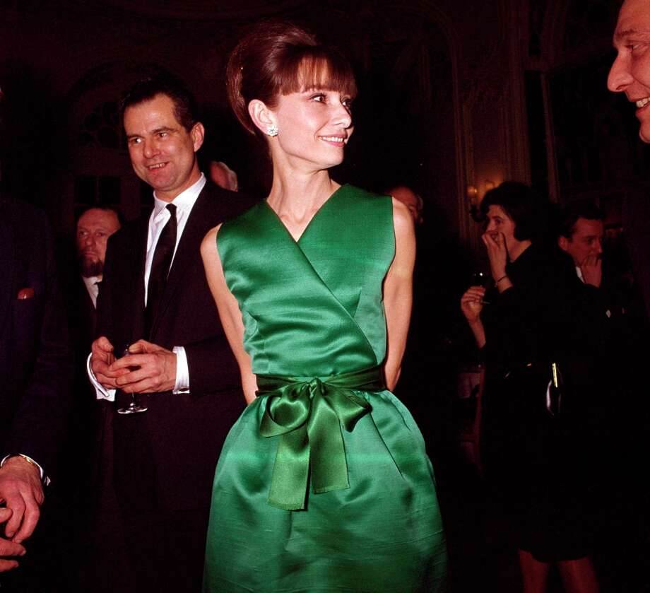 Actress Audrey Hepburn at a reception in a sleeveless emerald green satin V-neck cocktail dress with matching tied belt, in London, circa 1965. (Photo by Popperfoto/Getty Images). Photo: Popperfoto, Popperfoto/Getty Images / Popperfoto