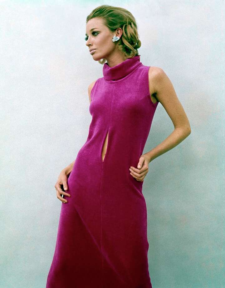 A model wears a purple sleeveless dress with a rolled collar and centre seam slit exposing her navel in a studio setting, circa 1968. (Photo by Popperfoto/Getty Images). Photo: Popperfoto, Popperfoto/Getty Images / Popperfoto