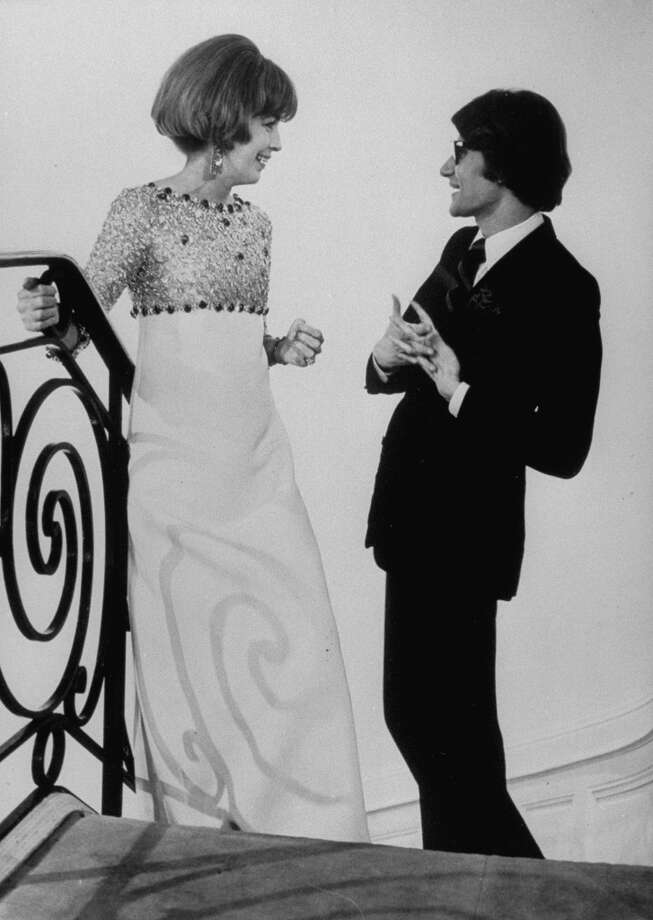 Fashion designer Yves Saint Laurent (R) talking with client Mrs. Stanley (Adele) Donen at his boutique.  (Photo by Pierre Boulat//Time Life Pictures/Getty Images) Photo: Pierre Boulat, Time & Life Pictures/Getty Image / Time Life Pictures
