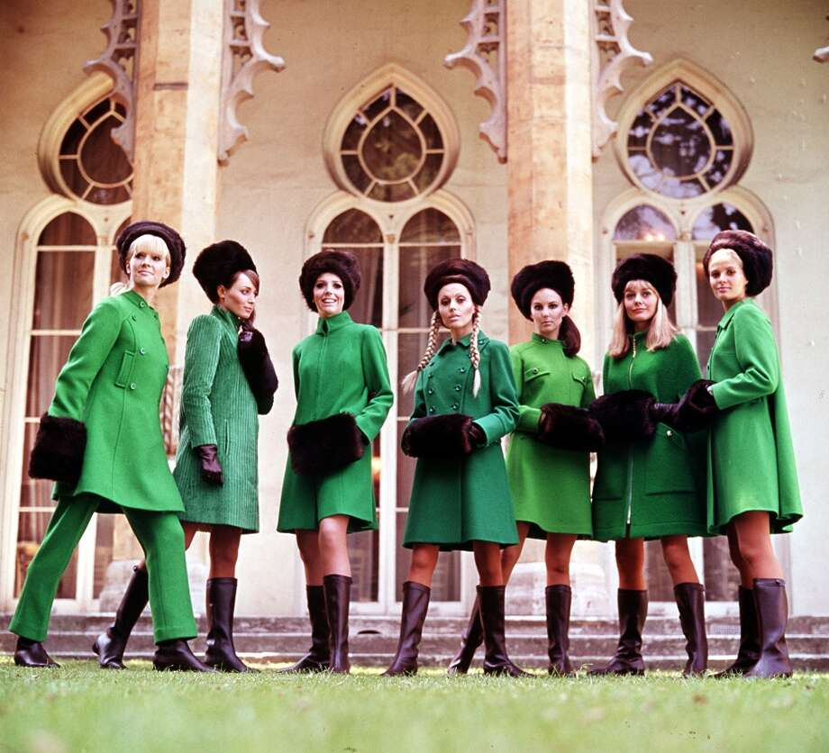 A group of young woman wearing green coats with black knee-high boots and black hats standing in a line in 1967. Photo: Popperfoto, Popperfoto/Getty Images / Popperfoto