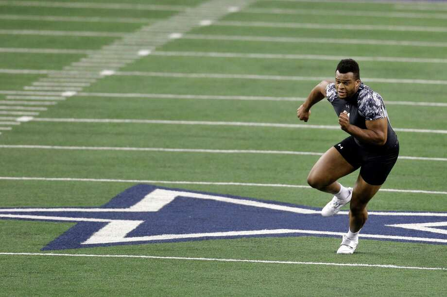 British Olympian Lawrence Okoye runs a defensive ends position drill during the NFL super regional football combine Sunday, April 7, 2013, in Arlington, Texas. (AP Photo/Tony Gutierrez) Photo: Associated Press