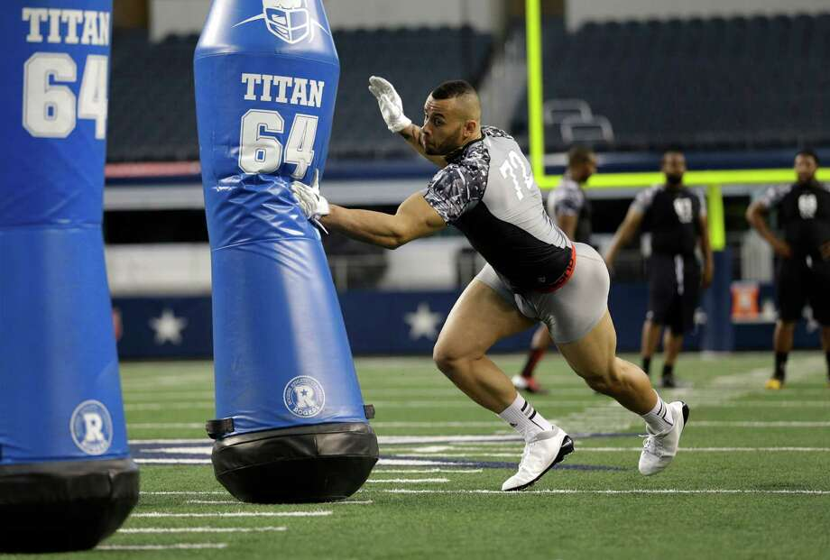 Defensive end Ben D'Aguilar (72) runs position drills during the NFL super regional football combine Sunday, April 7, 2013, in Arlington, Texas. (AP Photo/Tony Gutierrez) Photo: Associated Press